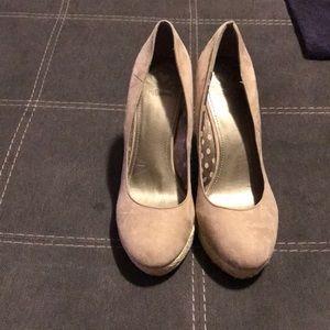 Beige heels with woven wedges.